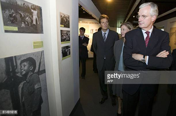 French Foreign Minister Michel Barnier followed by his wife Isabelle Barnier view an upcoming exhibition at a new museum in the Yad Vashem Holocaust...