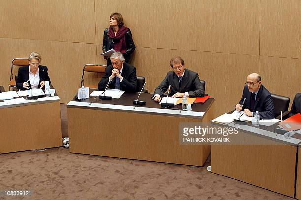French Foreign minister Michèle AlliotMarie and Defense minister Alain Juppe next to French deputy Axel Poniatowski also head of France's National...