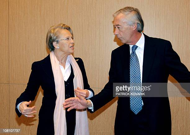 French Foreign minister Michèle AlliotMarie talks to French deputy Axel Poniatowski also head of France's National Assembly Foreign Affairs committee...