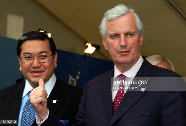 French Foreign ministerMichel Barnier jokes with his Thailand contrepart dr Surakiart Sathirathai during the family picture of the 6th ASEM Foreign...