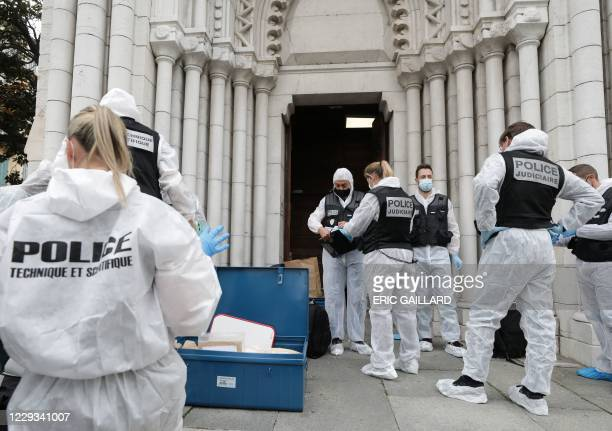 French forensics officers operate outside the Basilica of Notre-Dame de Nice after a knife attack in Nice on October 29, 2020. - France's national...