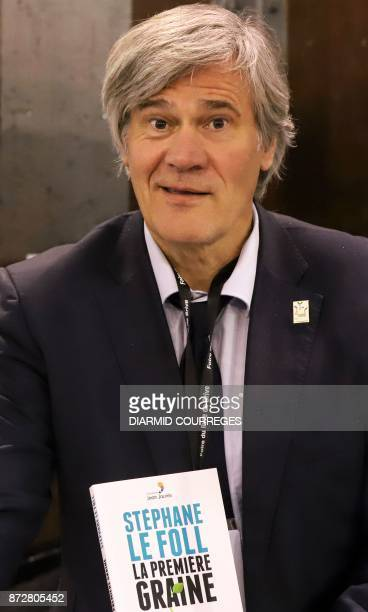 French former Agriculture minister Stephane Le Foll poses with his book during the 36th edition of the 'Foire du Livre de Brive' book fair on...
