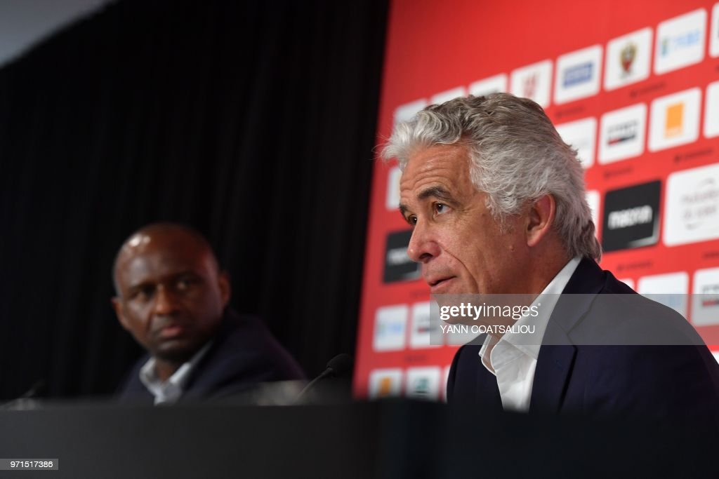 French former Arsenal and France star Patrick Vieira (L), world and European champion with Les Bleus, listens to French L1 football club of OGC Nice's president Jean-Pierre Rivere (R) during a press conference after being officialy appointed the club's new coach on June 11, 2018 in Nice. - Vieira, 41, arrives after a stint at MLS outfit New York City FC. He has signed a three-year contract and replaces Lucien Favre who is moving to Borussia Dortmund.