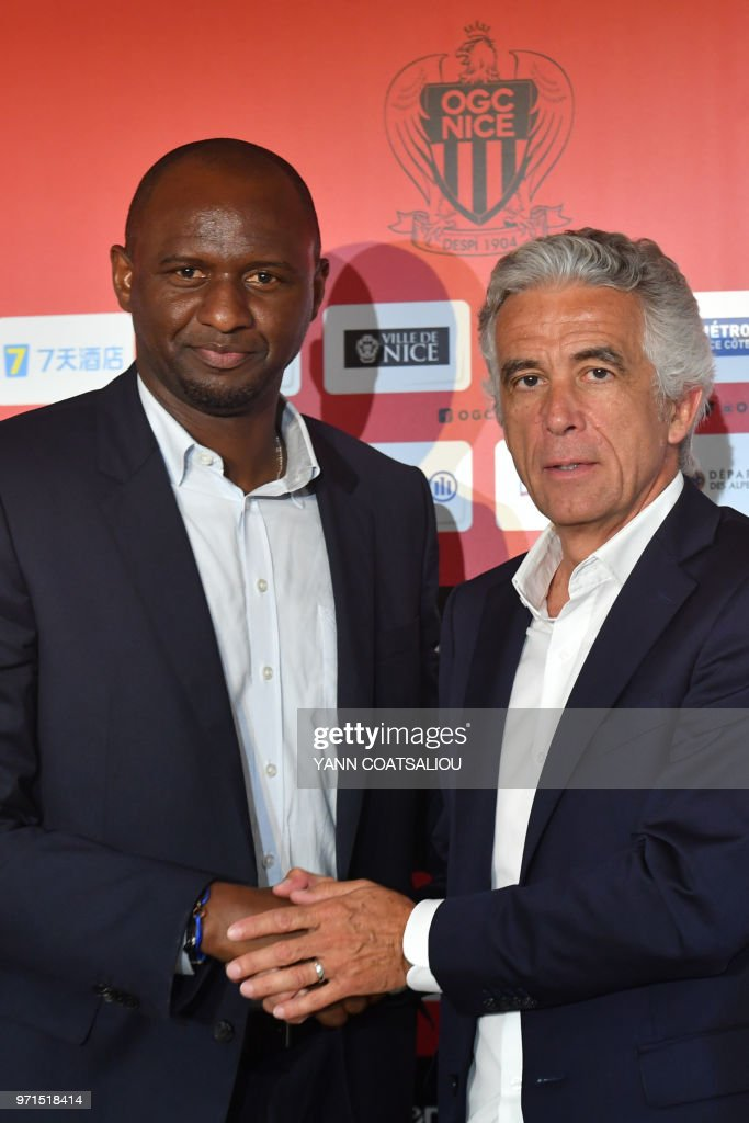 French former Arsenal and France star Patrick Vieira (L), world and European champion with Les Bleus, shakes hand with French L1 football club of OGC Nice's president Jean-Pierre Rivere (R) at the end of a press conference after being officialy appointed the club's new coach on June 11, 2018 in Nice. - Vieira, 41, arrives after a stint at MLS outfit New York City FC. He has signed a three-year contract and replaces Lucien Favre who is moving to Borussia Dortmund.