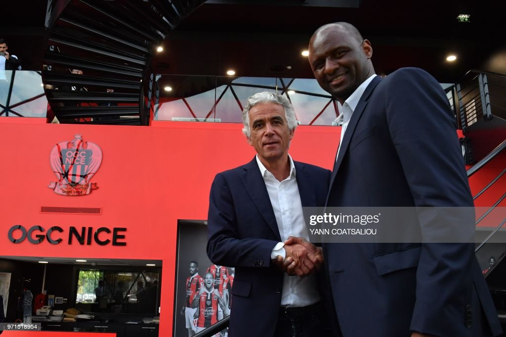 French former Arsenal and France star Patrick Vieira (R), world and European champion with Les Bleus, poses with French L1 football club of OGC Nice's president Jean-Pierre Rivere (R) at the end of a press conference after being officialy appointed the club's new coach on June 11, 2018 in Nice. - Vieira, 41, arrives after a stint at MLS outfit New York City FC. He has signed a three-year contract and replaces Lucien Favre who is moving to Borussia Dortmund.
