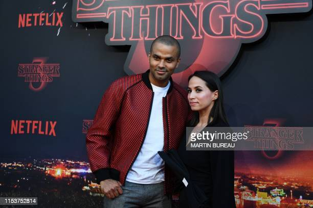 French former basketball player Tony Parker and his wife Axelle Francine pose during a photocall for the premiere of season 3 of the Netflix series...