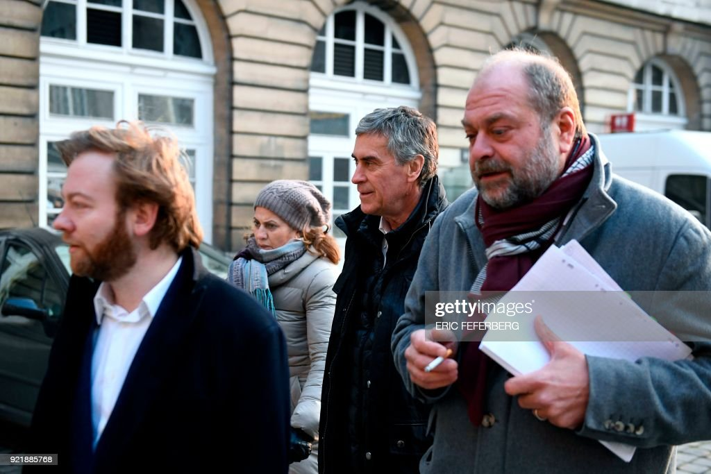 French former budget minister Jerome Cahuzac (C) and his lawyers Eric Dupond-Moretti (R) and Antoine Vey (L) arrive at Paris' courthouse on February 21, 2018 for the last day of his appeal trial on tax fraud and money laundering. French prosecutors asked on February 20, 2018 a court to uphold the three-year, tax-fraud sentence of a former Socialist budget minister who stashed hundreds of thousands of euros in a Swiss bank account. Jerome Cahuzac was forced to resign from government in 2013 after it emerged that that he had been squirreling away undeclared cash from his lucrative Parisian hair transplant clinic. PHOTO / Eric FEFERBERG