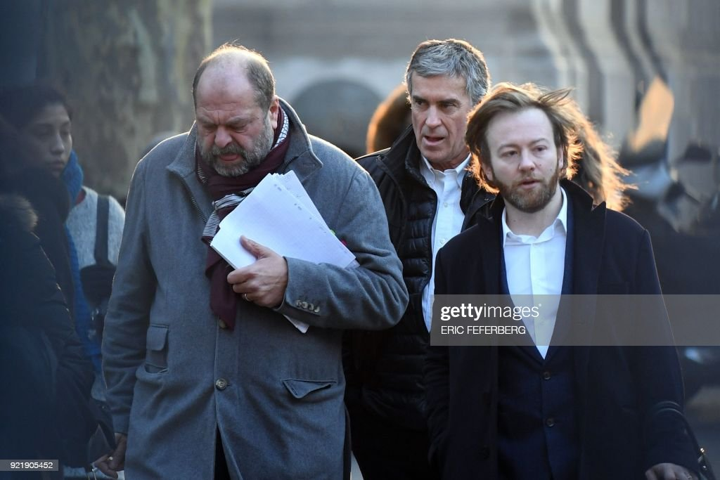 French former budget minister Jerome Cahuzac (C) and his lawyers Eric Dupond-Moretti (L) and Antoine Vey (R) arrive at Paris' courthouse on February 21, 2018 for the last day of his appeal trial on tax fraud and money laundering. French prosecutors asked on February 20, 2018 a court to uphold the three-year, tax-fraud sentence of a former Socialist budget minister who stashed hundreds of thousands of euros in a Swiss bank account. Jerome Cahuzac was forced to resign from government in 2013 after it emerged that that he had been squirreling away undeclared cash from his lucrative Parisian hair transplant clinic. PHOTO / Eric FEFERBERG