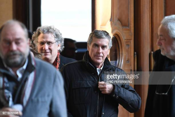 French former budget minister Jerome Cahuzac and his lawyers Eric DupondMoretti and JeanAlain Michel leave Paris' courthouse on February 21 2018 on...