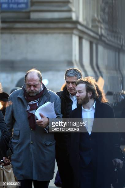 French former budget minister Jerome Cahuzac and his lawyers Eric DupondMoretti and Antoine Vey arrive at Paris' courthouse on February 21 2018 for...
