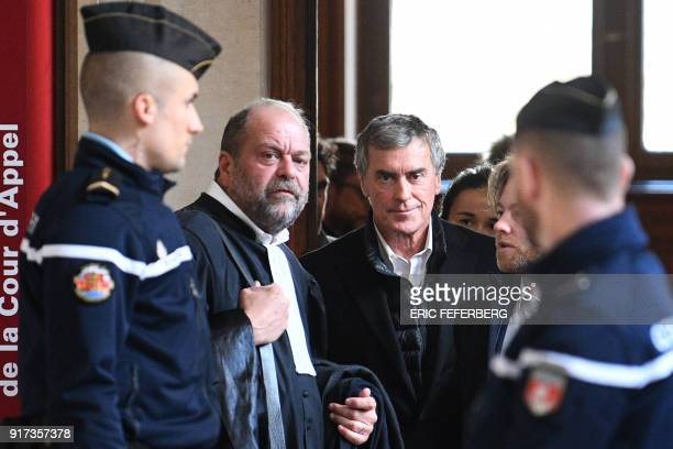French former budget minister Jerome Cahuzac flanked by his lawyer Eric DupondMoretti walks at the Paris courthouse during his appeal trial on tax...