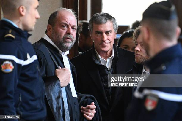TOPSHOT French former budget minister Jerome Cahuzac flanked by his lawyer Eric DupondMoretti leave the Paris courthouse during his appeal trial on...