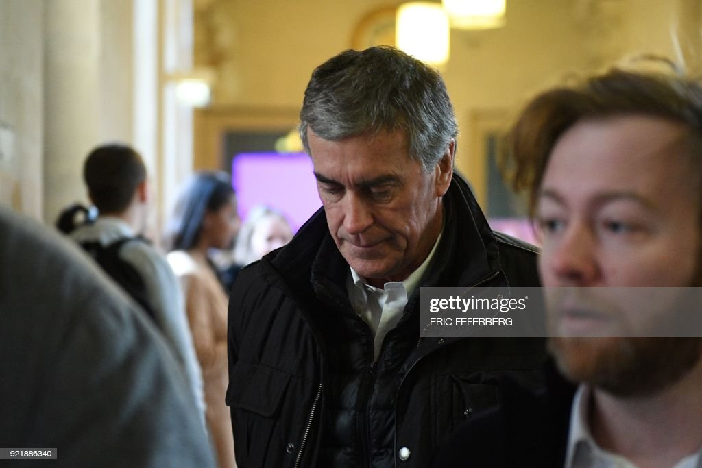 French former budget minister Jerome Cahuzac (C) looks on as he arrives with his lawyer Antoine Vey (R) at Paris' courthouse on February 21, 2018 for the last day of his appeal trial on tax fraud and money laundering. French prosecutors asked on February 20, 2018 a court to uphold the three-year, tax-fraud sentence of a former Socialist budget minister who stashed hundreds of thousands of euros in a Swiss bank account. Jerome Cahuzac was forced to resign from government in 2013 after it emerged that that he had been squirreling away undeclared cash from his lucrative Parisian hair transplant clinic. PHOTO / Eric FEFERBERG