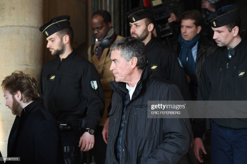 French former budget minister Jerome Cahuzac (C) reacts as he leaves Paris' courthouse on February 21, 2018 on the last day of his appeal trial on tax fraud and money laundering. The Paris Court of...