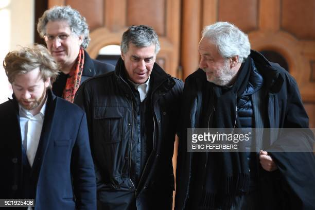 French former budget minister Jerome Cahuzac reacts as he leaves with his lawyers JeanAlain Michel and Antoine Vey Paris' courthouse on February 21...