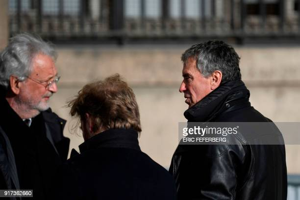 French former budget minister Jerome Cahuzac speaks with his lawyer JeanAlain Michel as they leave the Paris courthouse after a hearing in his appeal...