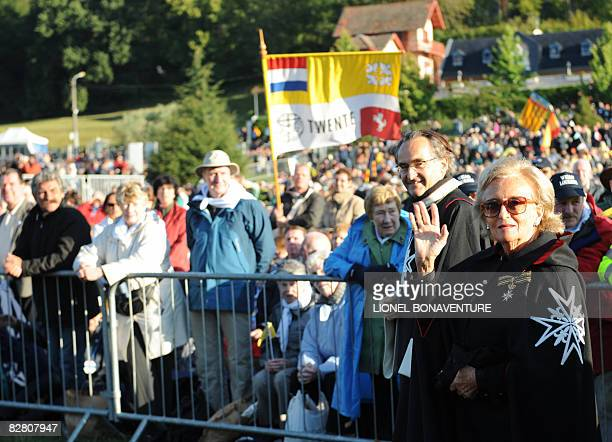 French former first lady Bernadette Chirac waves as she arrives to attend mass celebrated by Pope Benedict XVI at La Prairie in Lourdes on September...