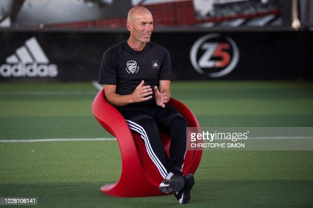 French former football player and today Real Madrid's head coach Zinedine Zidane speaks to journalists during the presentation of a sports and...