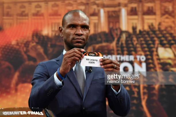 French former football player for Barcelona and Lyon Eric Abidal shows the slip of RB Liepzig during the draw for the quarter finals round of the...