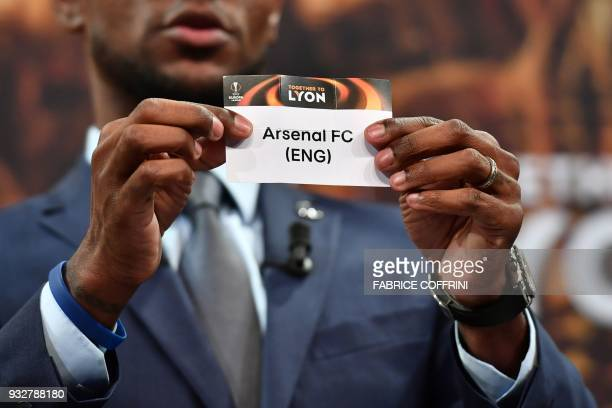 French former football player for Barcelona and Lyon Eric Abidal shows the slip of Arsenal FC during the draw for the quarter finals round of the...