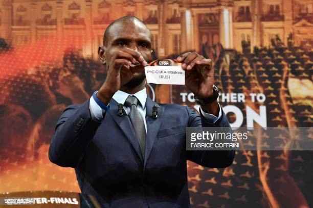 French former football player for Barcelona and Lyon Eric Abidal shows the slip of PFC CSKA Moskva during the draw for the quarter finals round of...