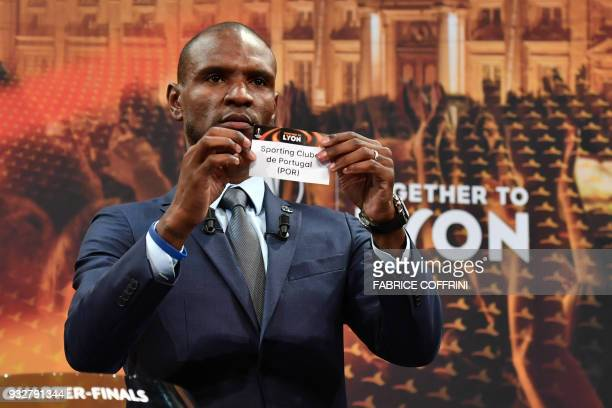 French former football player for Barcelona and Lyon Eric Abidal shows the slip of Sporting Club de Portugal during the draw for the quarter finals...