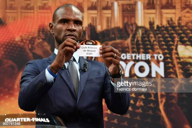 French former football player for Barcelona and Lyon Eric Abidal shows the slip of Club Atletico de Madrid during the draw for the quarter finals...