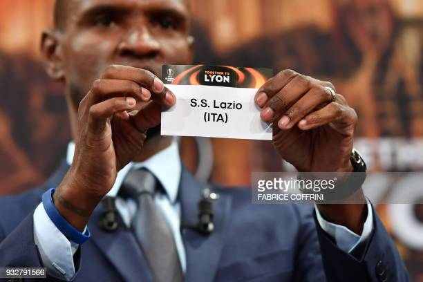French former football player for Barcelona and Lyon Eric Abidal shows the slip of SS Lazio during the draw for the quarter finals round of the UEFA...