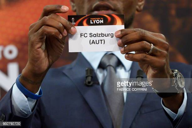 French former football player for Barcelona and Lyon Eric Abidal shows the slip of FC Salzburg during the draw for the quarter finals round of the...