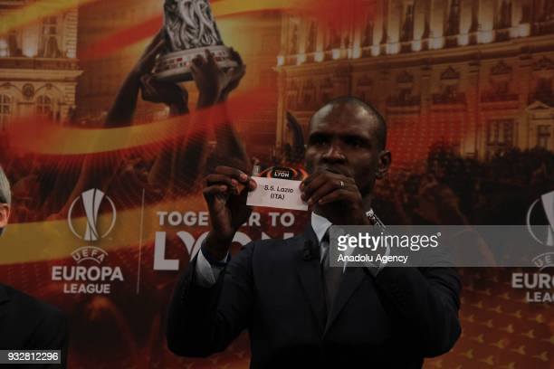 French former football player for Barcelona and Lyon Eric Abidal shows the slip of S S Lazio during the draw for the quarter finals round of the UEFA...