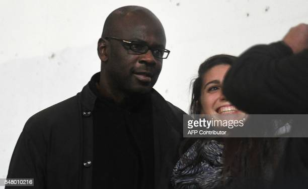 French former football player Lilian Thuram poses with a woman during the French L1 football match between Guingamp and Lille on September 16 2017 at...