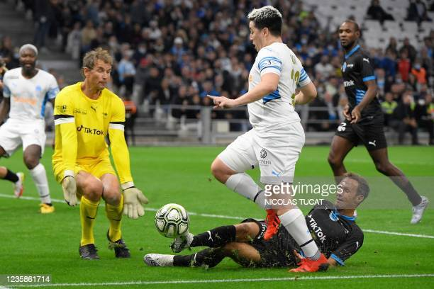 """French Former football player Samir Nasri fights for the ball with German former goalkeeper Jens Lehmann during the charity """"Heroes"""" football match..."""