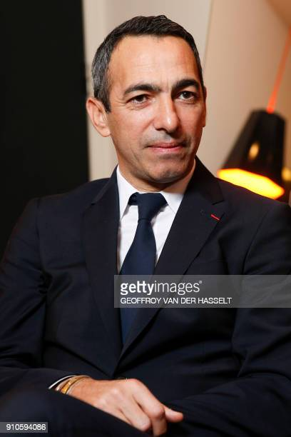 French former football player Youri Djorkaeff named ambassador of the Ligue de football professionnel poses for a photograph in Paris on January 25...