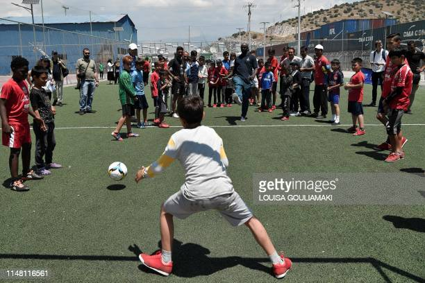 TOPSHOT French former football star and Barca foundation ambassador Lilian Thuram plays football with young refugees at the Skaramangas camp on the...