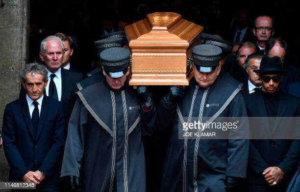 TOPSHOT French former Formula One pilot Alain Prost and British Formula One racing driver Lewis Hamilton walk next to the coffin of late Austrian...