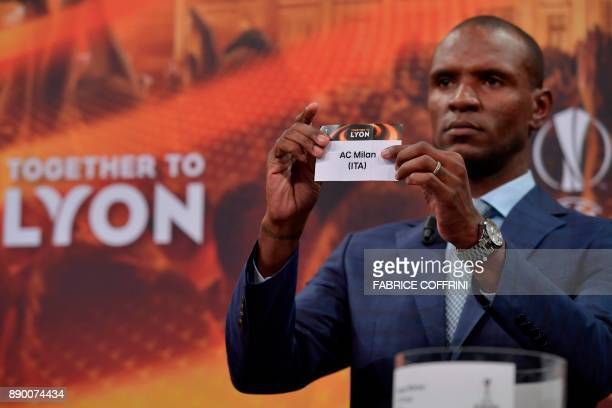 French former international Eric Abidal shows the slip of AC Milan during the draw for the round of 32 of the UEFA Europa League football tournament...
