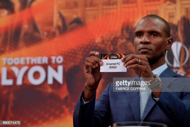 French former international Eric Abidal shows the slip of Arsenal during the draw for the round of 32 of the UEFA Europa League football tournament...