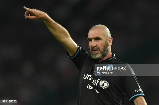 French former international Eric Cantona gestures during an England V Soccer Aid World XI charity football match for Soccer Aid for Unicef at Old...