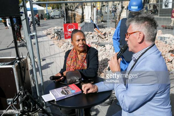 French former justice minister Christiane Taubira accompanied by the director general of Handicap International France JeanMarc Boivin takes part in...