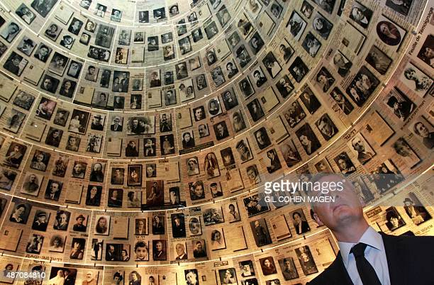 "French former minister and France's main opposition right-wing ""Les Republicains"" party MP, Bruno Le Maire looks at pictures of Jewish Holocaust..."