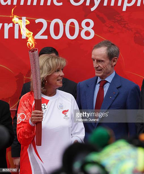 French former olympic champions skier JeanClaude Killy and French former olympic champion swimmer Christine Caron attend the Beijing Olympics torch's...