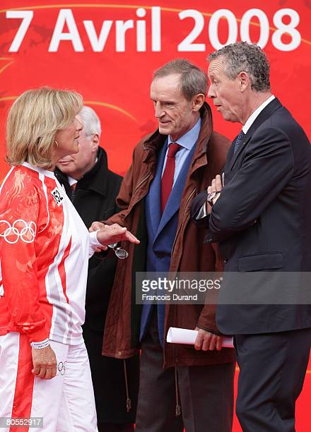 French former olympic champions skier JeanClaude Killy athlete Guy Drut and swimmer Christine Caron attend the Beijing Olympics torch's arrival at...