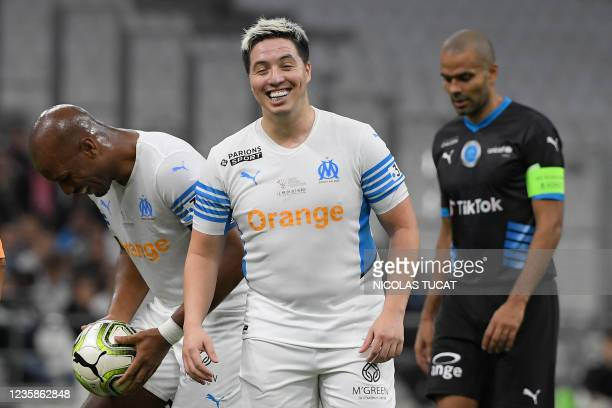 """French former player Samir Nasri reacts during the charity """"Heroes"""" football match between former Olympique de Marseille's players and Team Unicef,..."""
