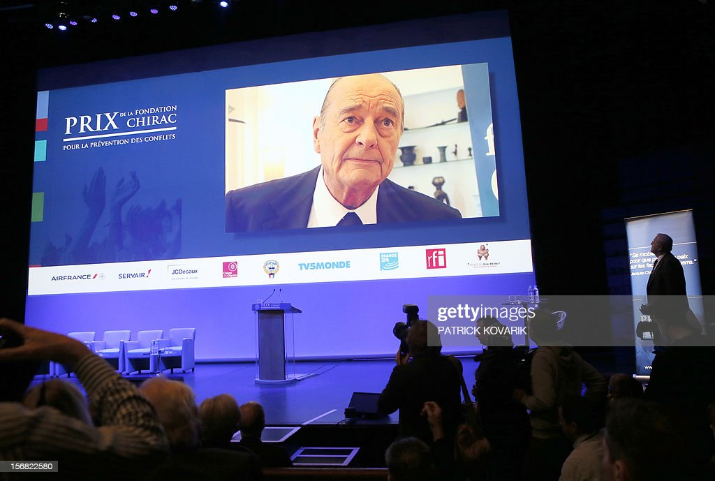 French former President Jacques Chirac adresses a video message during the ceremony of release of the Jacques Chirac Foundation's 2012 Award for the prevention of conflicts, on November 22, 2012 at the Quai Branly Museum in Paris.