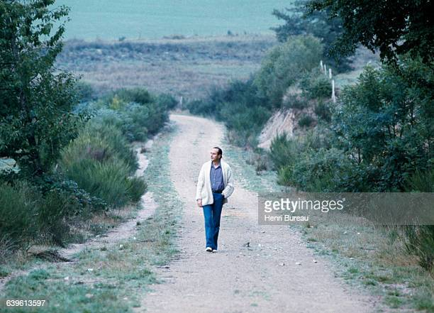 French Former Prime Minister and President of the Rally for the Republic Jacques Chirac walking in the countryside in Correze