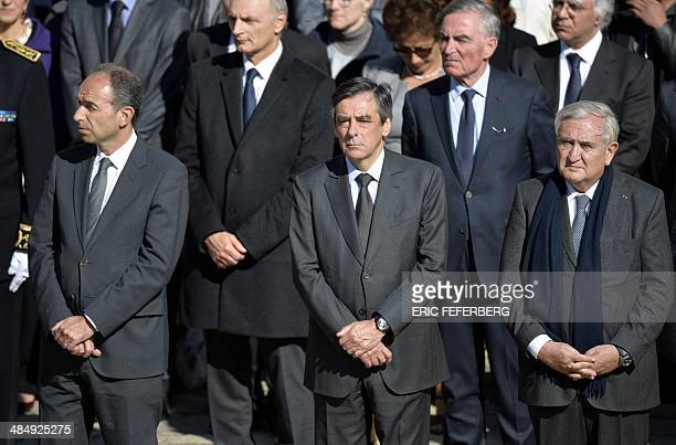 French former Prime ministers JeanPierre Raffarin and Francois Fillon and UMP right wing party president JeanFrancois Cope take part on April 15 2014...