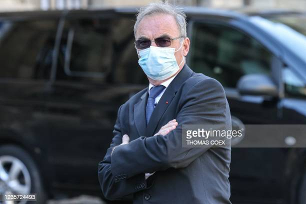 French former professional cyclist Bernard Hinault arrives to attend the mass in memory of French business magnate, actor and politician Bernard...