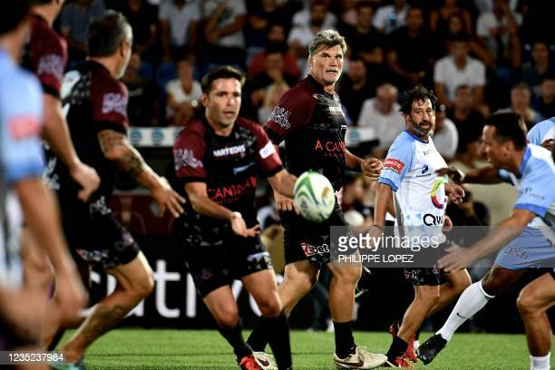 French former rugby player Fabien Pelous looks on during a charity football and rugby union match between former French football players and former...
