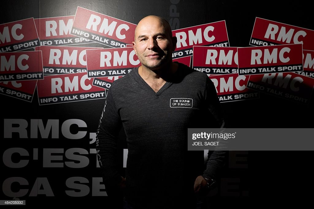 French former rugby union player and radio host Vincent Moscato poses on August 26, 2014 at the headquarters of the French-Monegasque radio station RMC in Paris.