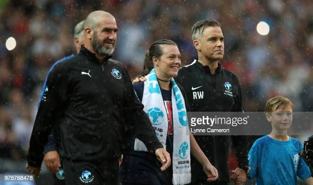 French former soccer player Eric Cantona and Robbie Williams with the mascots during the Soccer Aid for UNICEF 2018 match between England and The...